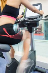 Woman exercising on an exercise bike at the gym
